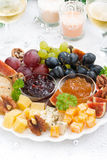 Delicacy cheese and fruit plate to the holiday, vertical Royalty Free Stock Photo