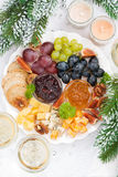 Delicacy cheese and fruit plate to the holiday, vertical Royalty Free Stock Photos