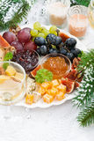 Delicacy cheese and fruit plate, vertical, top view Royalty Free Stock Photography