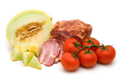 Delicacy mellon ham and tomato Stock Image