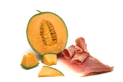 Delicacy -melon and meat. On white background stock images