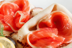 Delicacy pancakes with red fish closeup Royalty Free Stock Photos
