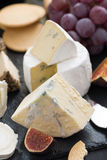 Delicacy soft cheeses, fruit and crackers - snacks for wine Royalty Free Stock Photography