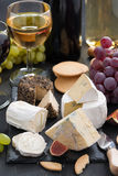 Delicacy soft cheeses, fruit and crackers - snacks for wine Stock Image