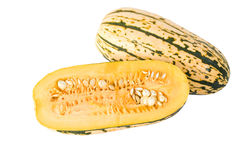Delicata Squash. A Delicata squash split open to show it's seeds and inner pulp Stock Image