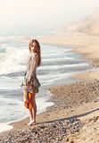 Delicate. Beautiful delicate girl with violin on the seashore Royalty Free Stock Photo