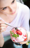 Delicate alluring lady with dessert Stock Image