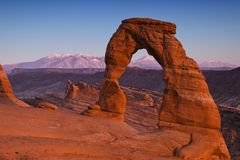 Delicate Arch. Utah's iconic Delicate Arch in Arches National Park at dusk.  In the backdrop are the LaSal Mountains Stock Images