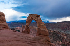 Delicate arch in Arches national Park, beneath a stormy sky Stock Photos