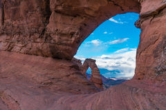 Delicate arch in Arches national Park, viewed through a hole in Stock Photo