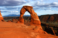 Delicate Arch Landscape. Delicate Arch frames the snow-capped La Sal Mountains, Arches National Park, Utah Stock Image