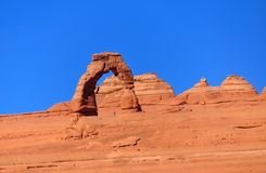 Delicate Arch and a man in late fall Royalty Free Stock Photography