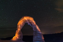 Delicate Arch at Night against Beautiful night sky Royalty Free Stock Photos