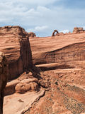 Delicate Arch perched on sandstone cliff Stock Photo