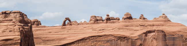 Delicate Arch and sandstone canyon. Delicate Arch sits on top of the red sandstone canyon wall in Arches National Park in Utah Royalty Free Stock Photos