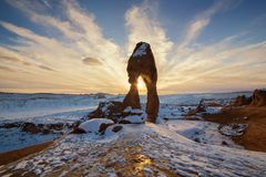 Delicate Arch with Snow  during Sunset. This is the picture of Delicated Arch with snow during sunset at Arches National Park, Utah Stock Image