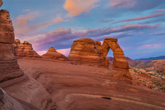 Delicate Arch at Sunset. Delicate Arch against Beautiful Sunset Sky Stock Photo