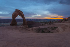 Delicate Arch after Sunset. Colorful sunset sky over Delicate Arch - Moab Utah Stock Image