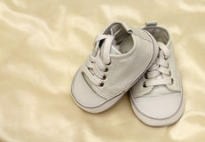 Delicate baby shoes Stock Images