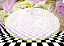 Delicate background with roses on a chess surface Stock Photography