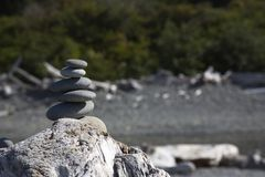Delicate balance of stacked rocks stock image