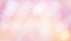 Delicate Beautiful Background with bokeh. Delicate Beautiful Abstract Blurred Pink Yellow White Background with Bokeh circles. Soft Texture with particles. Wide Stock Photos