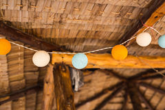 Delicate, beautiful lanterns garlands like balls of yarn. New Year's and Christmas decorations. Stock Photo