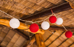 Delicate, beautiful lanterns garlands like balls of yarn. New Year's and Christmas decorations. Royalty Free Stock Photography