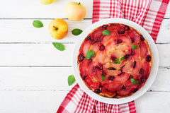 Delicate biscuit cake with apples and cherries Royalty Free Stock Photos