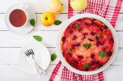 Delicate biscuit cake with apples and cherries Stock Images