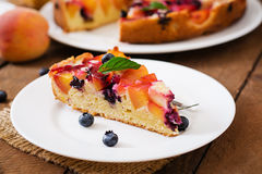 Delicate biscuit pie with peaches. And blueberries Royalty Free Stock Photo