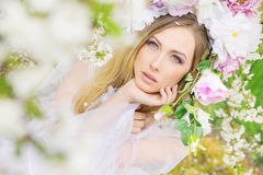 Delicate blonde in the summer garden Royalty Free Stock Photo