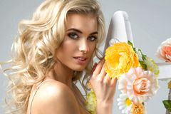 Delicate blonde woman with floral. White ladder Stock Images