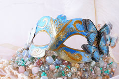 delicate blue venetian mask next to pearls and jewel Stock Image