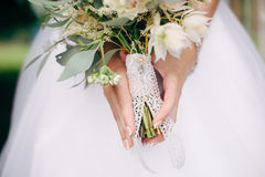 Delicate bouquet the bride. With a key Royalty Free Stock Photography