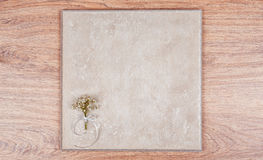 Delicate bouquet of flowers and a wooden abstract background. Stock Photography