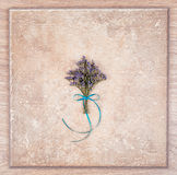 Delicate bouquet of flowers and a wooden abstract background. Royalty Free Stock Photography