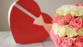Delicate bouquet of pink and white roses . box with a gift in the form of heart stock video