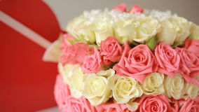 Delicate bouquet of pink and white roses . box with a gift in the form of heart stock video footage