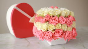 Delicate bouquet of pink and white roses . box with a gift in the form of heart stock footage