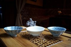 Beautiful dishes for a tea ceremony close-up on a wooden board with statues royalty free stock photos