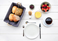 Delicate breakfast at a white table Stock Photo