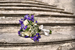 Delicate bridal bouquet on the gray stone steps Stock Photos