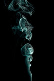 Delicate and bright smoke waves on dark background Stock Image