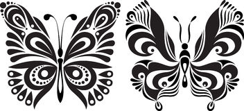 Delicate butterfly silhouette. Drawing symmetrical image. Options stock photo