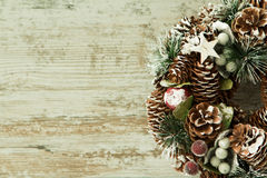 Delicate Christmas wreath of pine cones Stock Photos