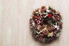 Delicate Christmas wreath of pine cones Stock Photo