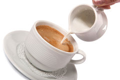 Delicate cream poured into cup of coffee Royalty Free Stock Photo