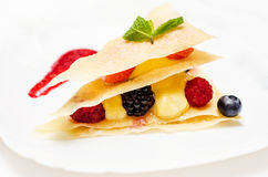 Delicate dessert. With vanilla cream and berries Royalty Free Stock Photography