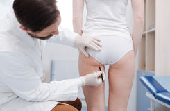 Delicate experienced plastic surgeon performing preparation marking Stock Images